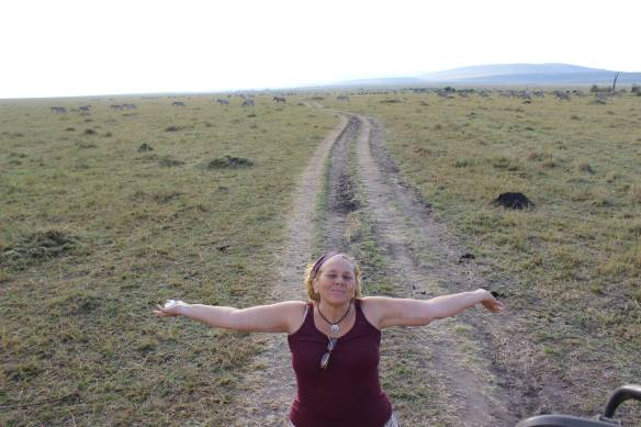 I JUMPED OUT FOR A QUICK PIT STOP, MAYA CAUGHT ME... ZEBRA AND WILDEBEEST IN THE BACKGROUND... AMAZING!
