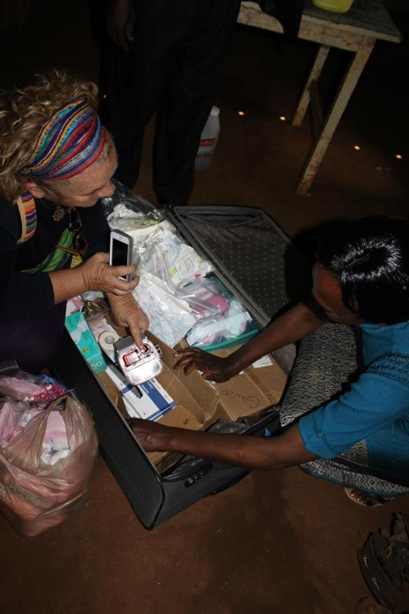 Showing Evelyne the medical supplies that I collected and brought with me. Donations provided by many of my midwife friends and the birth centers they work at.